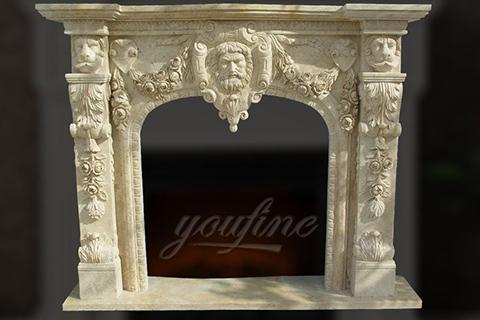 Декоративный  бежевый мраморный каминный портал с головой льва